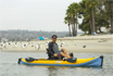Paddling the Hobie i12s inflatable kayak at the beach